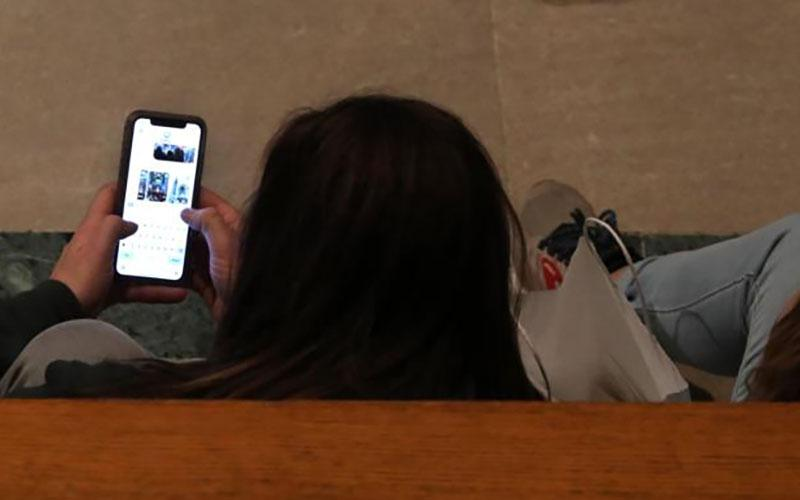 A girl looking at her phone