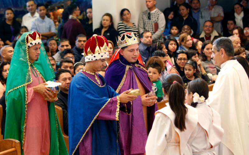 Young men dressed as the Three Kings present the gifts during a Spanish-language Mass on the feast of the Epiphany at St. John of God Church in Central Islip, N.Y.