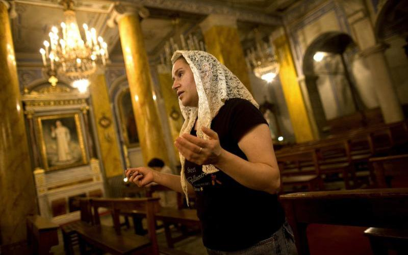 A woman prays in the Cathedral of the Holy Spirit in Istanbul.