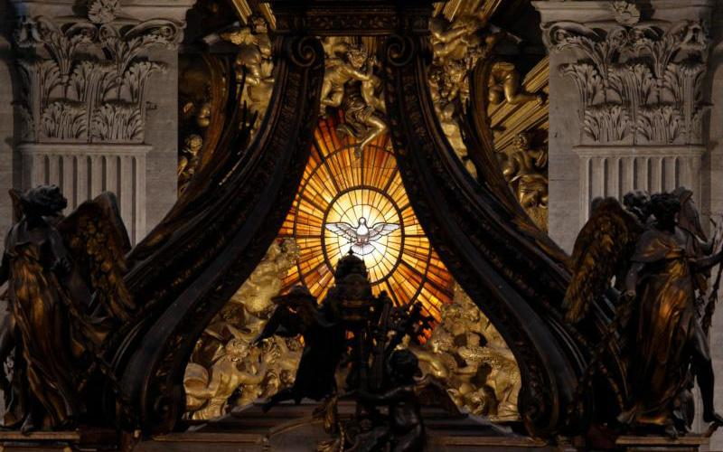 The Holy Spirit window is pictured through the Baldacchino at St. Peter's Basilica in the Vatican.