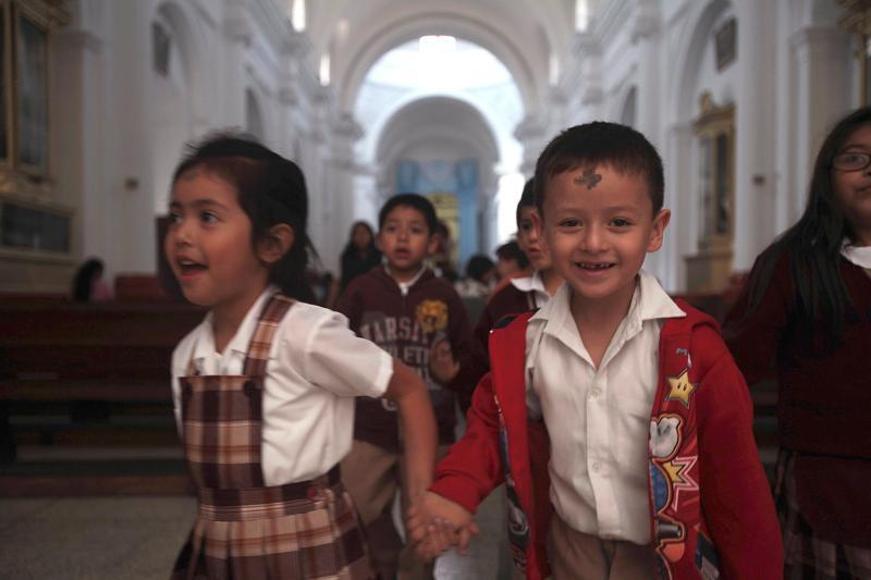 Children exit a church after receiving ashes during an Ash Wednesday Mass in Guatemala City Feb. 13, 2013.