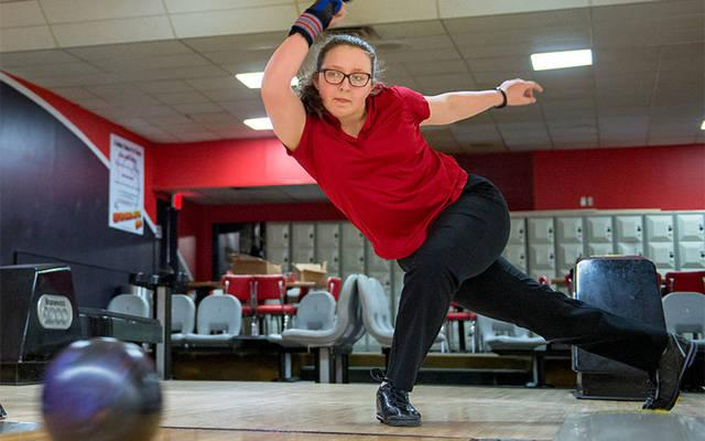 <p>Record-setting bowler Elena Carr takes some practice throws at AMF Dewey Garden Lanes in Greece March 28.  </p>