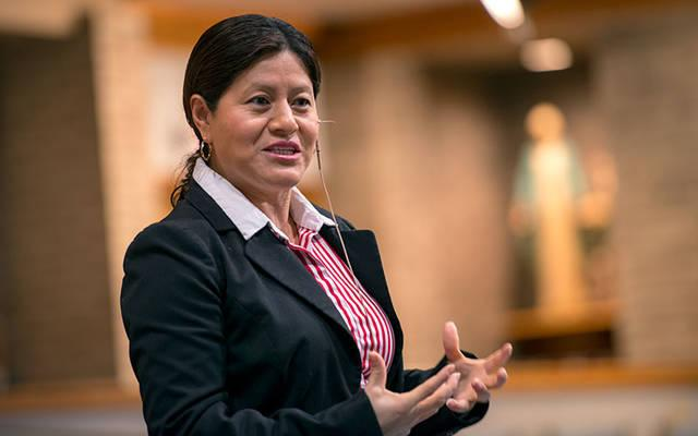 <p>Mexican migrant Librada Paz speaks during a Feb. 22 Lenten retreat session at St. Helen Church in Gates.  (Courier photo by Jeff Witherow) </p>