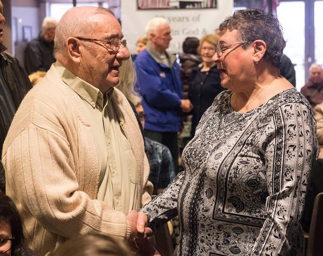 <p>Paul and Pauline Mangione renew their marriage vows April 14 at St. Christopher Church in North Chili as part of the parish&rsquo;s 50th-anniversary celebration. (Courier photo by John Haeger)  </p>