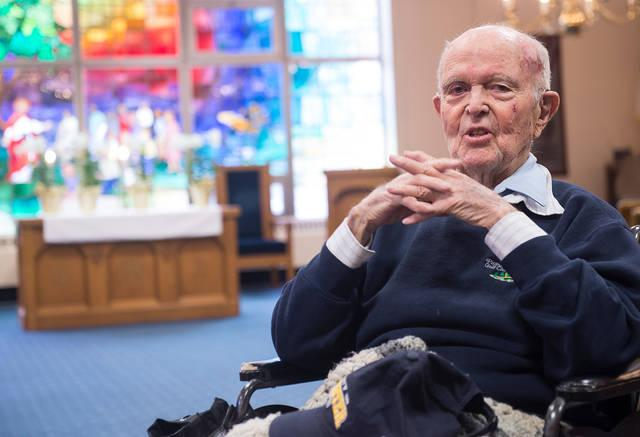 """<p>John """"Jack"""" Reinhardt poses during an interview at Fairport Baptist Homes April 10. Reinhardt, 95, has volunteered his whole life and continues to do so at the Fairport facility. (Courier photo by John Haeger)  </p>"""