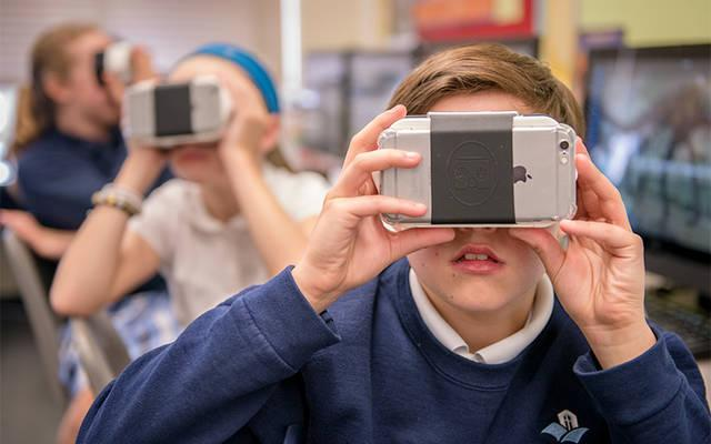 <p>Fifth-grader Braeden Goetz uses virtual reality in the technology classroom at Pittsford's St. Louis School May 1. (Courier photo by Jeff Witherow) </p>
