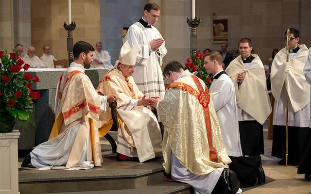<p>Father Michael Merritt's hands are anointed by Bishop Salvatore R. Matano during the June 3, 2017, priest ordination Mass at Rochester's Sacred Heart Cathedral. (File photo)  </p>
