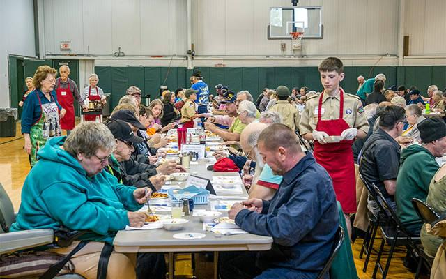 <p>Diners fill the tables at Ss. Peter and Paul's gymnasium in Elmira May 16 during the Free Spaghetti Supper, an annual event sponsored by Blessed Sacrament Parish. (Photo by Rick Bacmanski) </p>