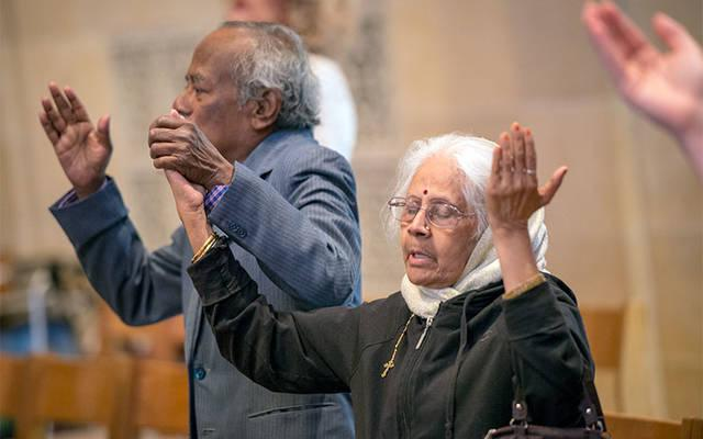<p>Isabella and Thiagaraj Nevis, who are celebrating 50 years of marriage, stand during the liturgy. (Courier photo by Jeff Witherow) </p>