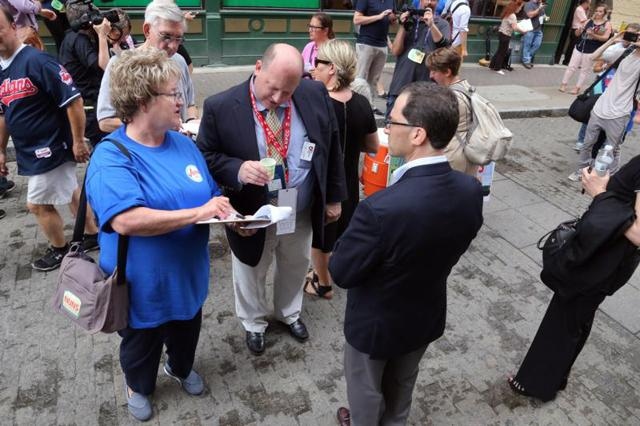 Sister Julie Ann Krahl, a member of the Congregation of the Sisters of St. Agnes in Fond du Lac, Wis., collects information from bystanders July 18 outside the Republican National Convention in Cleveland.