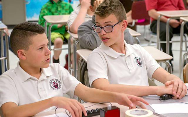 <p>Siena Catholic Academy Academic Challenge Bowl members Nathan Tette (left) and Graham Fox confer during the Rochester-area playoffs May 10 in Fairport. (Courier photo by John Haeger) </p>