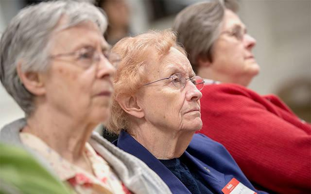 <p>Sister Dolores Ann Stein listens to refugees&rsquo; stories during a May 9 event at Our Lady of the Americas Church in Rochester.  </p>