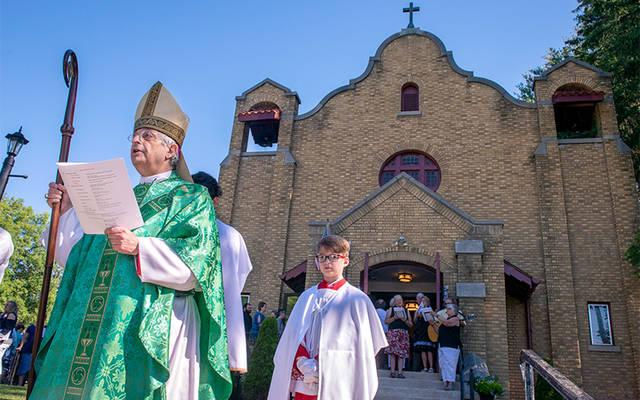 <p>Bishop Salvatore R. Matano participates in a procession led by parishioners of Cohocton&rsquo;s St. Pius V Church during a July 8 celebration of the building&rsquo;s 100th anniversary. (Courier photo by Jeff Witherow)  </p>