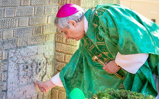 <p>Bishop Salvatore R. Matano blesses the cornerstone of St. Pius V Church in Cohocton before a July 8 Mass celebrating the building&rsquo;s 100th anniversary. (Courier photo by Jeff Witherow)  </p>
