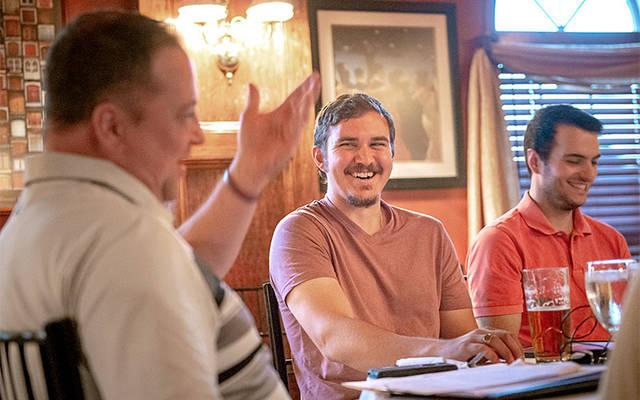 <p>Jarrod Shafer (center) and Zack Lincoln (right) react to David Prete (left) during a Sept. 14 Faith on Tap discussion at Club 57 in Hornell. (Courier photo by Jeff Witherow)   </p>