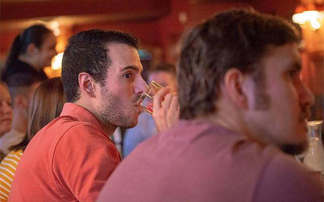 <p>Zack Lincoln listens to the discussion during a Sept. 14 Faith on Tap at Club 57 in Hornell. (Courier photo by Jeff Witherow) </p>