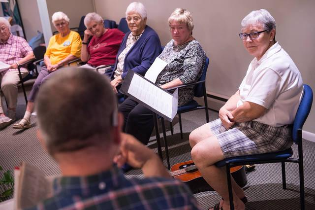 <p>Sister Jody Kearney (right) listens Aug. 7 as Father Ray Fleming speaks during a retreat at Mercy Spirituality Center in Rochester. The center is celebrating its 40th anniversary this year. (Courier photo by John Haeger) </p>