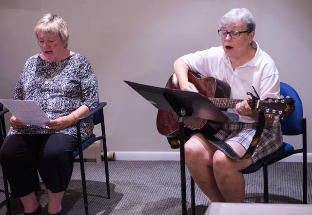 <p>Sister Jody Kearney plays the guitar during a retreat at Mercy Spirituality Center in Rochester on Aug. 7. (Courier photo by John Haeger)  </p>