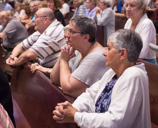 <p>Parishioners pray during an Aug. 15 Mass at St. Mary Church in Auburn that celebrated the Solemnity of the Assumption of the Blessed Virgin Mary and also the parish's 150th anniversary.  </p>