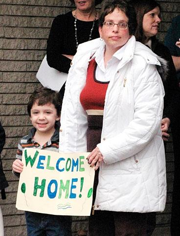 Matthew Samuelson and Katie Jablonski welcome back students to St. Patrick School Nov. 14.