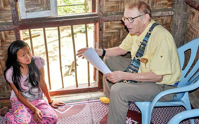 <p>Bill Cook educates children in Myanmar on HIV during a recent trip. (Photo courtesy Bill Cook) </p>