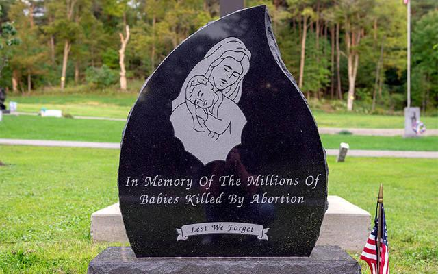 <p>A memorial recalling the unborn &mdash; made possible by the Knights of Columbus and other pro-life advocates &mdash; was dedicated at Holy Cross Cemetery in Dansville in 2016. (Courier photo by Jeff Witherow)  </p>