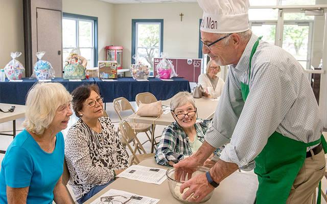 <p>Chet Fery explains his hobby of sharing kindness through bread making during an Aug. 22 presentation at St. Mary Church in Honeoye. (Courier photo by John Haeger)  </p>