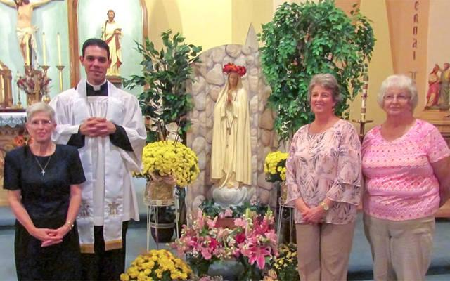 <p>Elaine Lasater (from left) Father Anthony Amato, Kathy Joyce and Shirley Lopreste pose for a photo Oct. 9 following a Living Rosary at St. James Church in Waverly. (Photo courtesy Elaine Lasater)</p>