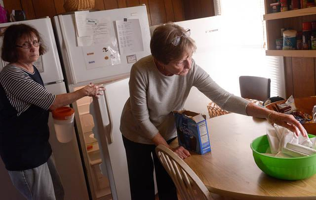 <p>Barbara Hildreth (left) and Jane Kelly, parishioners of St. Patrick Church in Victor, get ready to serve dinner at the Canandaigua Veterans Club Oct. 9. (Courier photo by John Haeger) </p>