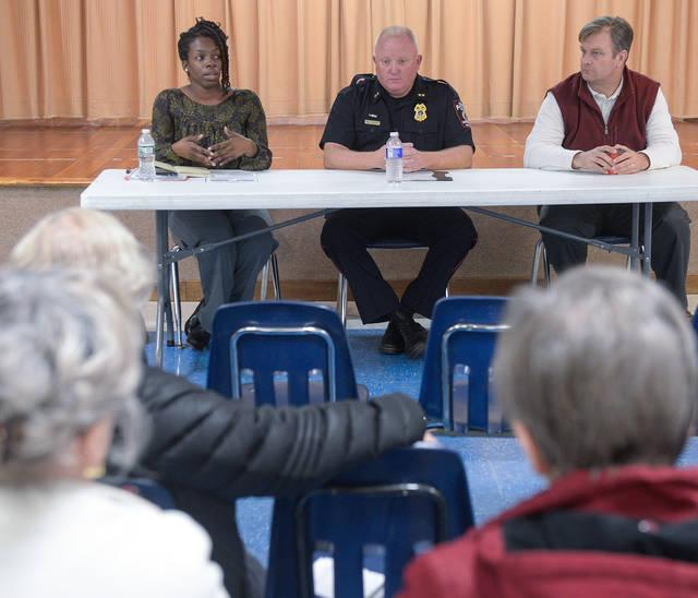 <p>Greece Chief of Police Patrick Phelan talks about the opioid epidemic as Shawn James , an addiction therapist from Villa of Hope looks on during a open forum on the opioid crisis held at St. Charles Borromeo Church in Rochester on Oct. 22. (Courier Photo by John Haeger) </p>