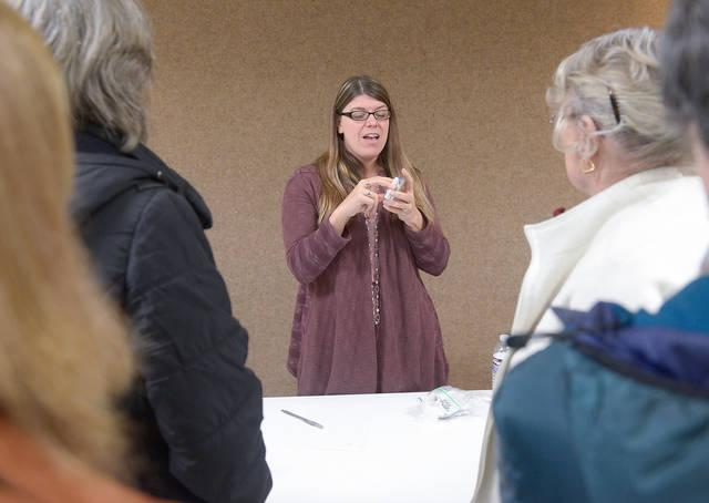 <p>During a forum on the opioid crisis Oct. 22 at Greece's St. Charles Borromeo Church, Stacey Gray, a registered nurse from Villa of Hope, explains how to administer Narcan to someone who has overdosed on opioids. </p>