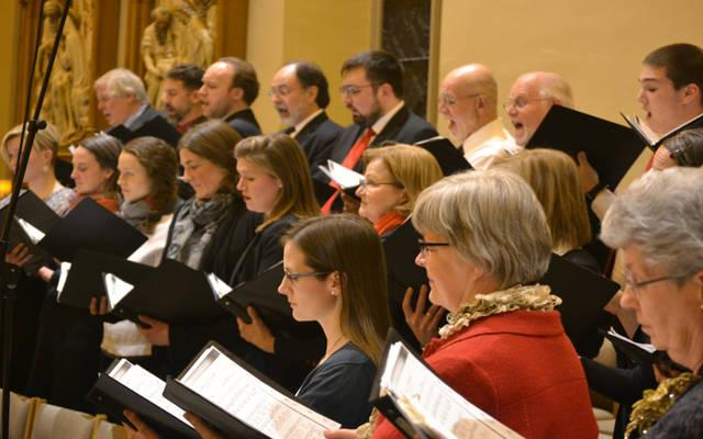 <p>A volunteer choir made up of members of several different Christian churches in the Dubuque, Iowa, area performs the Lessons and Carols program at St. Raphael Cathedral in January 2018. Jim Mendralla, liturgy and music director at the cathedral, has been leading the performances since coming to Dubuque in 2008. (CNS photo by Dan Russo)  </p>