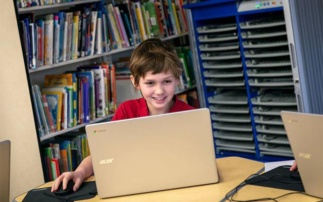 <p>Sixth-grader Giles Yaddow uses one of the new Chromebooks in St. Agnes School's new computer lab following a ribbon-cutting ceremony Jan. 18. (Courier photo by Jeff Witherow) </p>