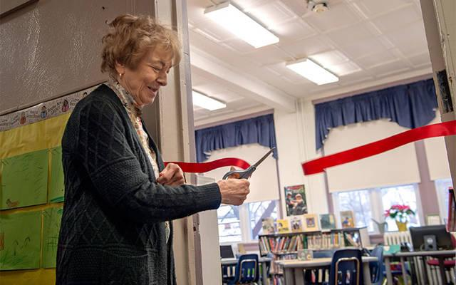 <p>Barb Herman cuts the ribbon to mark the official opening of the computer lab at St. Agnes School in Avon Jan. 18. (Courier photo by Jeff Witherow)  </p>