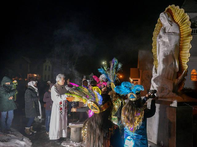 <p>Father Jesus Flores blesses a statue of Our Lady of Guadalupe outside the Mission of Our Lady of Guadalupe in Marion Dec. 12.  </p>