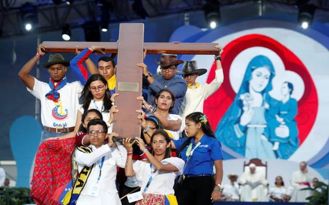<p>Pilgrims carry the World Youth Day cross as Pope Francis joins them in the Way of the Cross at Santa Maria la Antigua Field in Panama City Jan. 25. (CNS photo by Carlos Jasso/Reuters)  </p>