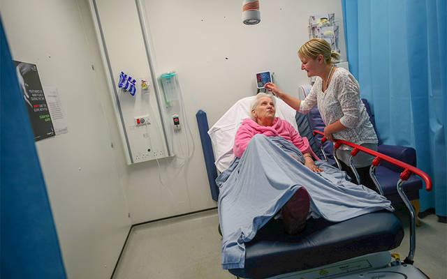 <p>Sarah Plant comforts her grandmother, Barbara Lant, who awaits treatment at Milton Keynes University Hospital in England June 26, 2018. &ldquo;If we had to pay for health care, we wouldn&rsquo;t have been able to afford it. I don&rsquo;t really want to think about what it would have been like,&rdquo; said Plant. (CNS photo by Hannah McKay/Reuters)  </p>
