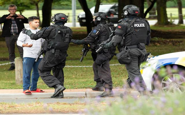 <p>Members of a SWAT team push back members of the public following a shooting at the Al Noor Mosque in Christchurch, New Zealand, March 15. New Zealand's Catholic bishops have expressed their horror and distress at terrorist attacks on two mosques in Christchurch; at least 49 people were killed. (CNS photo by Martin Hunter/Reuters)  </p>