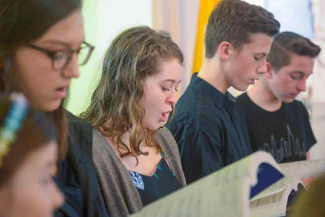 <p>Good Shepherd Catholic Community Junior Choir members sing during the 10:30 a.m. Mass at Our Lady of the Lake Church in King Ferry April 7. (Courier photo by John Haeger) </p>