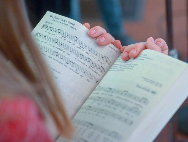 <p>Good Shepherd Catholic Community Junior Choir members sings during the 10:30 a.m. Mass at Our Lady of the Lake Church in King Ferry on April 7. (Courier photo by John Haeger) </p>