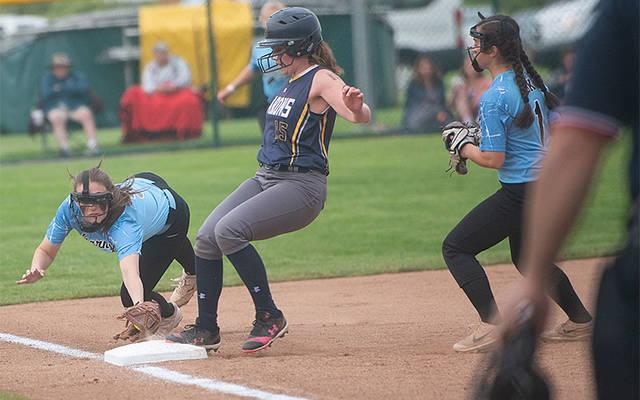 <p>Brighton&rsquo;s Bridget Kerwin (15) safely steps on third base as Bishop Kearney&rsquo;s shortstop, Anna DiChristina (5), dives to touch the bag in the bottom of the second inning of the Section 5 Class A1 final in Brockport May 31. Backing up the play is BK&rsquo;s Marissa Giannavola (1). Brighton won the game 4-3 to advance to the next round. (Courier photo by John Haeger)  </p>
