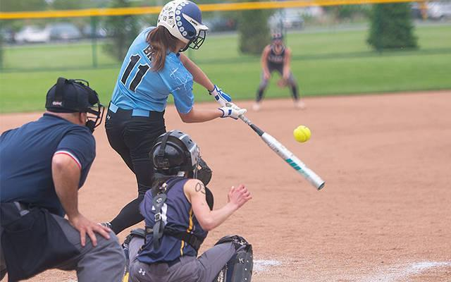 <p>Brighton&rsquo;s catcher Anna Purtell (3) looks on as Bishop Kearney&rsquo;s Lauren Bernard (11) connects with the ball in the third inning of the Section 5 Class A1 final in Brockport May 31. Brighton won the game 4-3 to advance to the next round. (Courier photo by John Haeger)  </p>