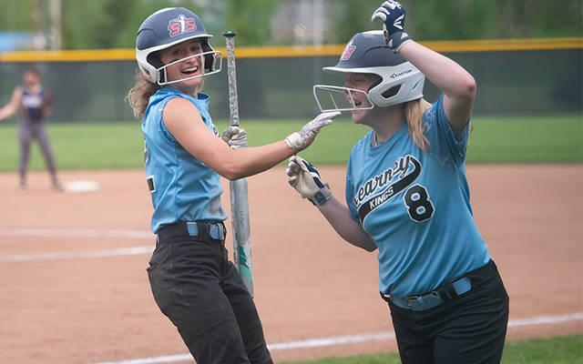 <p>Bishop Kearney&rsquo;s Brianna Boon (12) and Emily Phelan (8) celebrate scoring two runs on a hit by Lauren Bernard (11) (not pictured) in the third inning of the Section 5 Class A1 final in Brockport May 31. Brighton won the game 4-3 to advance to the next round. (Courier photo by John Haeger)  </p>