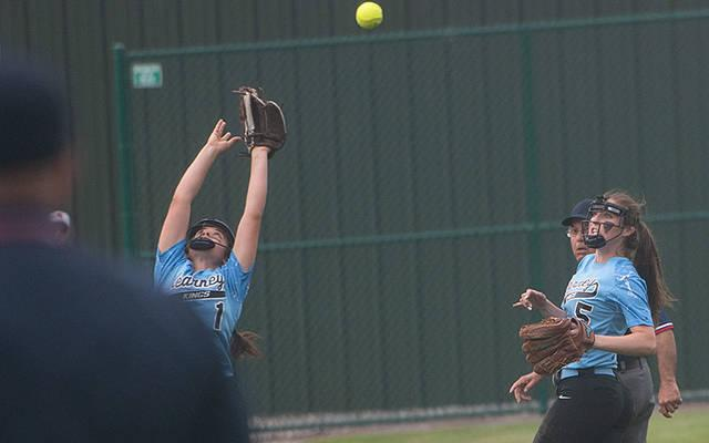 <p>Bishop Kearney&rsquo;s Marissa Giannavola (1) reaches but is unable to catch a foul ball as teammate Anna DiChristina (5) backs up the play during the Section 5 Class A1 final against Brighton May 31 in Brockport. Brighton won the game 4-3 to advance to the next round. (Courier photo by John Haeger)  </p>