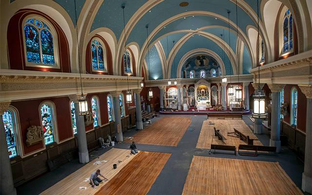 Canandaigua's St. Mary Church is undergoing a restoration, which includes fresh paint on the walls and ceiling, new pews and oak confessionals. (Courier photo by Jeff Witherow)