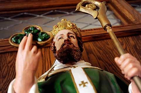 A colorful statue of St. Patrick greets parishioners as they enter St. Patrick Church in Victor.