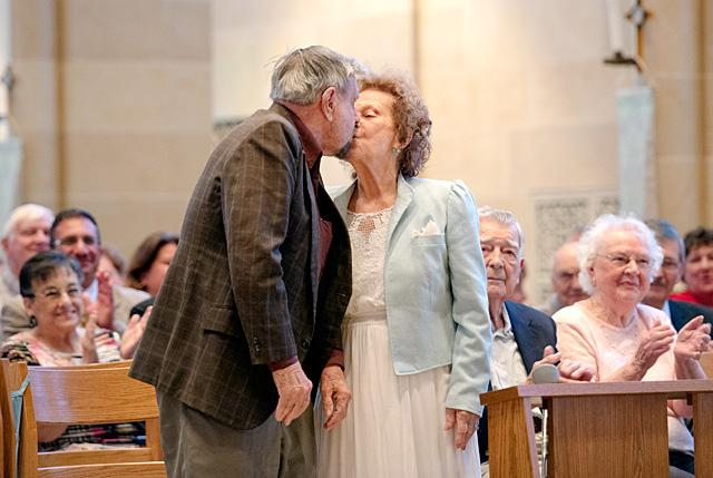 Robert and Dolores Crowell share a kiss during the annual Wedding Jubilee Mass May 17 at Rochester's Sacred Heart Cathedral. They celebrate 66 years of marriage in June.