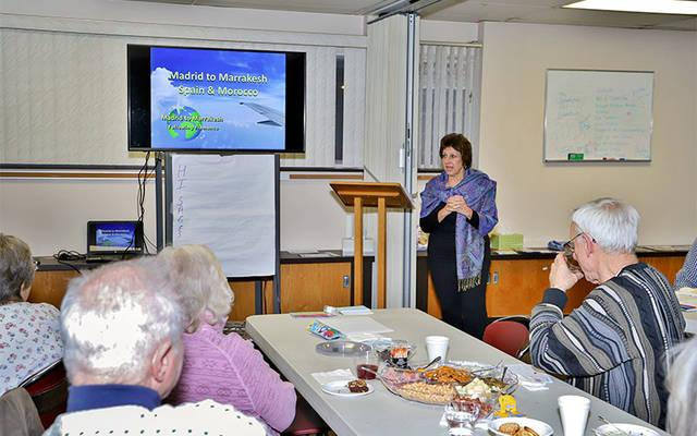 <p>LuAnn Irwin talks about her travels through Spain and Morocco during St. Maximilian Kolbe Parish&rsquo;s March 9 TAB Talk. (Photo courtesy of Dennis O&rsquo;Keefe)  </p>