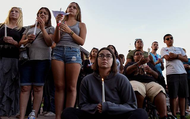 <p>People attend a candlelight vigil outside Gilroy City Hall in California July 29 to honor those that died and were injured during a mass shooting at the Gilroy Garlic Festival a day earlier. The Diocese of San Jose held a bilingual prayer vigil July 29 for victims, survivors and first responders at St. Mary Church in Gilroy. (CNS photo by Kate Munsch/Reuters)  </p>