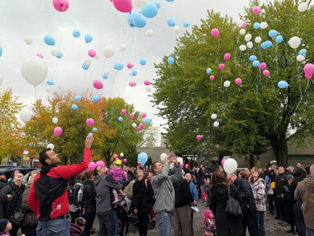 Parents who have lost babies release balloons at St. Cecilia Church in Quebec City for the Feast of the Angels Oct. 17.